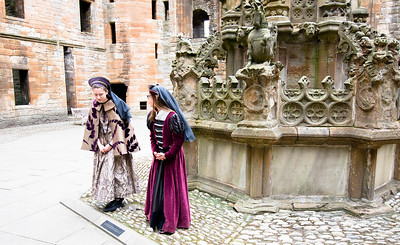 a couple of young girls that give tours of the palace.