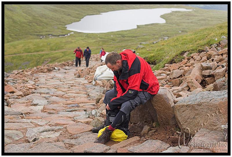 A short rest on the wet rocks of Ben Nevis.