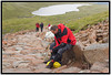 A short rest on the wet rocks of Ben Nevis.