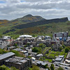 Arthur's Seat , a volcanic crag, carved by glaciers towers above Edinburgh.<br /> (Scotland's new Parliament building is at the foot.)