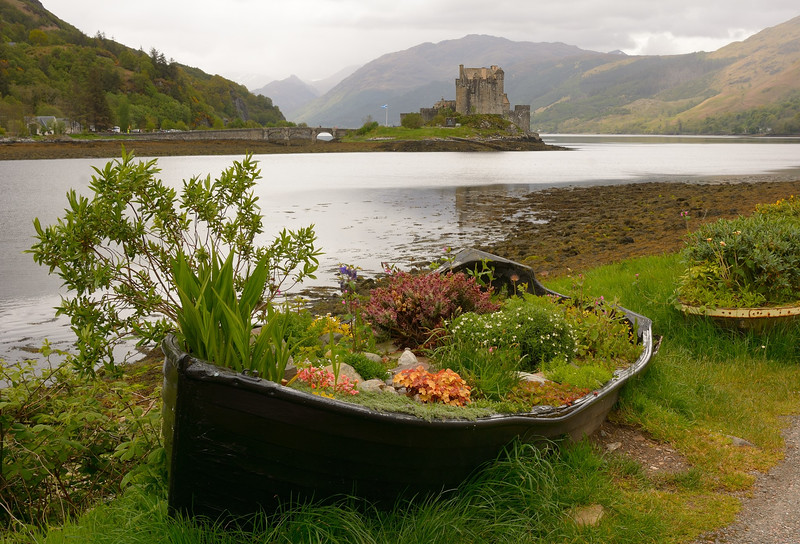 Eilean Donan Castle  viewed at low tide from Dornie , Scotland.<br /> May 30, 2015.