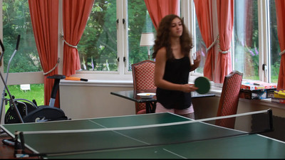 Table tennis in the game room.