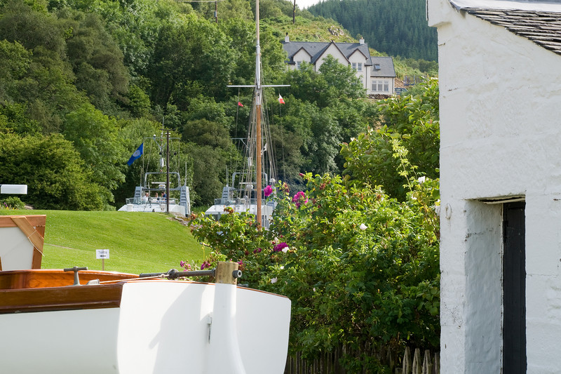 Crinan, with the lock-keeper's roses and two RN P2000 class patrol boats in the basin.