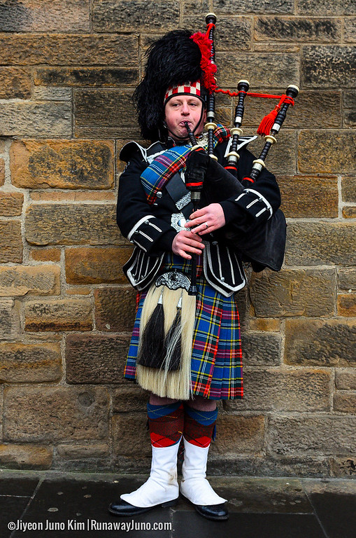 A bagpipe player on the Royal Mile