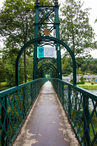 Footbridge over the River Tummel to the Community Theater and the hydroelectric dam.