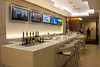 LAX-American Airlines Business Class Lounge Bar. Do-it-yourself wine, beer, and hard likker are also available in the buffet area.