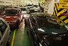The cargo deck. Three rows of cars, trucks, and buses on either side of the centrally located engine room and access stairways. Capacity is about 36 cars and four 18-wheel trucks and/or buses.