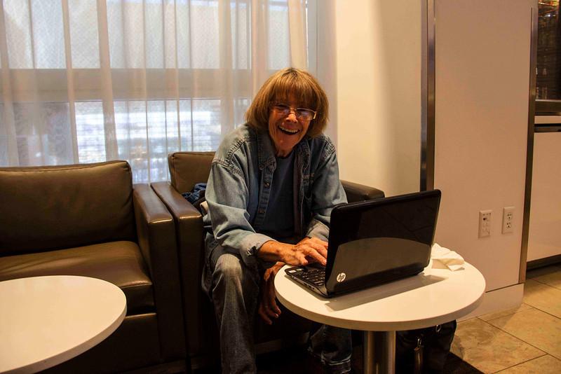 Jan enjoying a little pre-flight Words With Friends