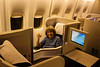 British Airways Business Class (Front of the plane is to the right. Aisle seat is in foreground.)