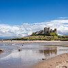Bamburgh Castle is located on the coast at Bamburgh in Northumberland, England. Castle from the beach.