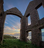 Looking out thru the remains of Slains Castle at sunrise - Cruden Bay, Scotland.