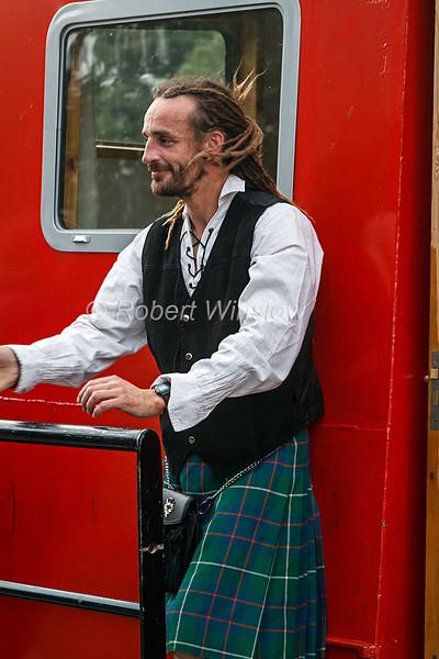 "Skipper,  Dave ""Swampy"" Roberts, Wearing a Kilt, Ros Crana Barge, Caledonian Canal; Great Glen Way; Scottish Highlands, Scotland; United Kingdom, Europe"