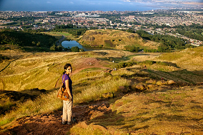 Smitha turns back while we hike down from the peak of Arthur's Seat