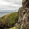 The Berwickshire Coastline of high cliffs over deepclear water with sandy coves and picturesque harbours. .