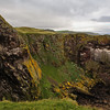The Berwickshire Coastline of high cliffs over deep clear water.