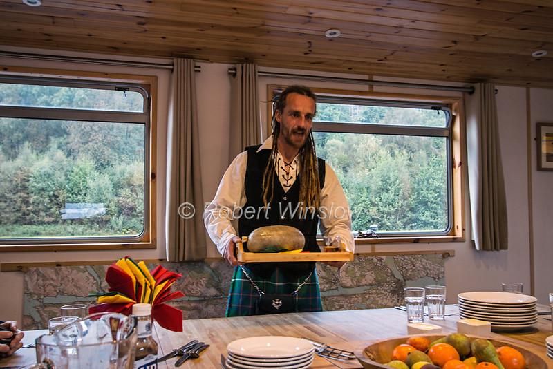 "Skipper,  Dave ""Swampy"" Roberts, Wearing a Kilt, Serviing Haggis, Ros Crana Barge, Caledonian Canal; Great Glen Way; Scottish Highlands, Scotland; United Kingdom, Europe"