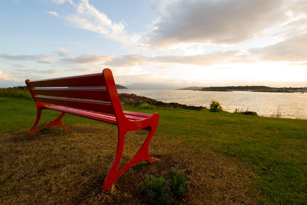 Red bench at sunset, Millport Scotland
