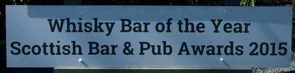 Part of the sign in front of the Ballygrant inn on Islay