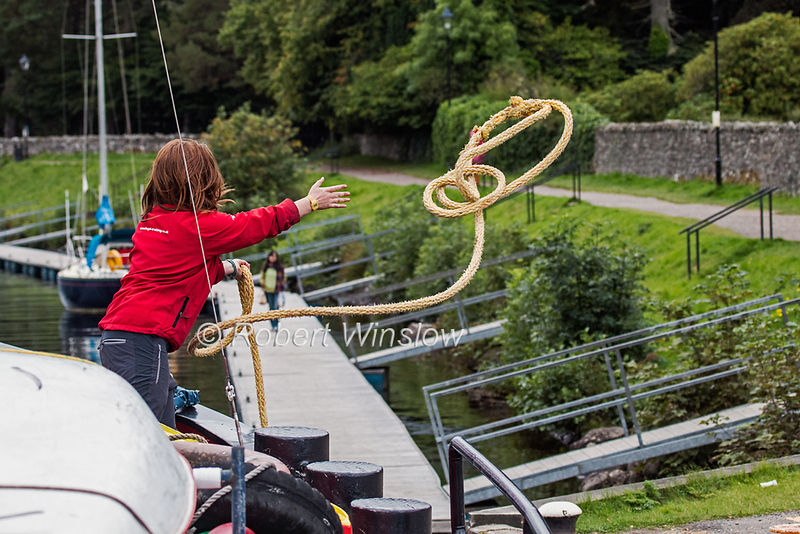 Lucy throwing Rope while docking, Fort Augustus,  Scottish Highlands, Great Glen Way, Caledonian Canal, Scotland, United Kingdom, Europe
