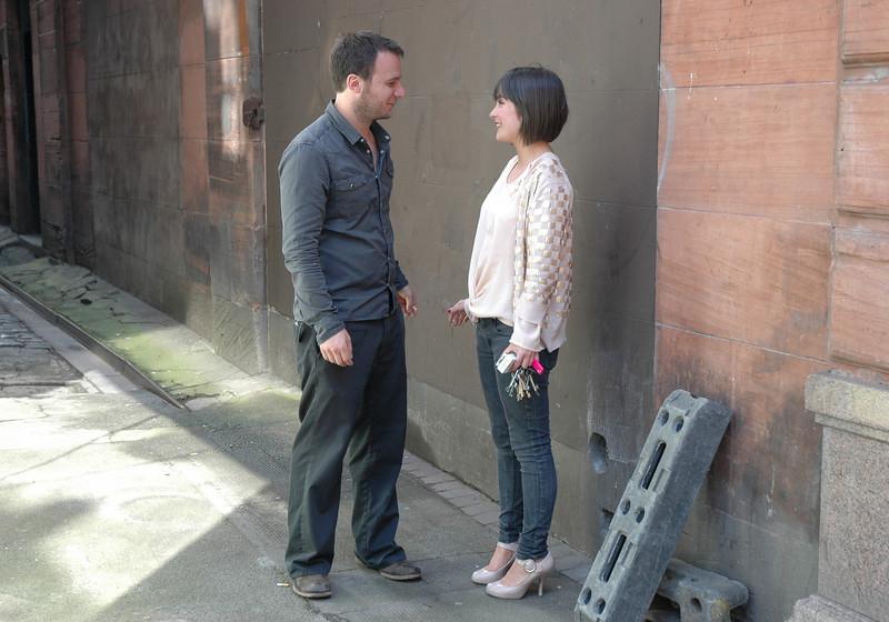 Glasgow couple grabbing a smoke in an alley.