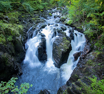 The Black Linn waterfall on the River Braan, in the Hermitage park in Dunkeld, Scotland.
