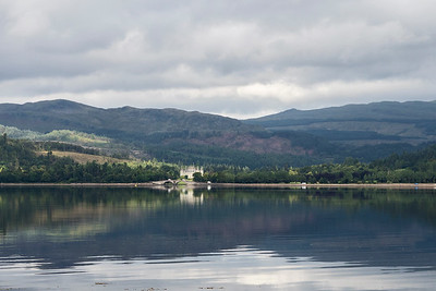Looking across Loch Fyne towards Inveraray Castle and Bridge