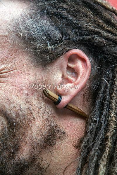 "Skipper,  Dave ""Swampy"" Roberts, Wood peg in his ear, Ros Crana Barge, Caledonian Canal; Great Glen Way; Scottish Highlands, Scotland; United Kingdom, Europe"