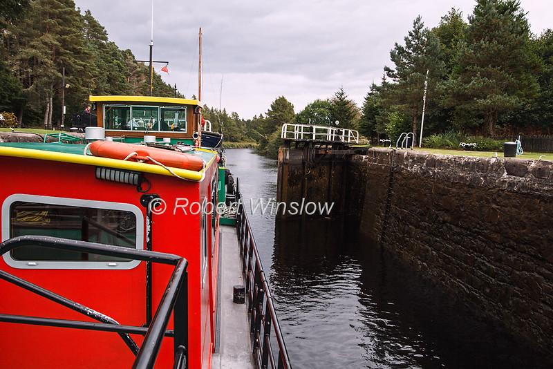 Ros Crana Barge, In a lock, Caledonian Canal; Great Glen Way; Scottish Highlands, Scotland; United Kingdom, Europe