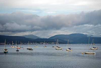 Sailboats at anchor in a bay near Greenock