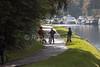 Bicyclers on pathway, Caledonian Canal; Great Glen, Scottish Highlands, Scotland, United Kingdom, Europe