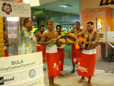 Traditional sulus being worn by singers at the airport.