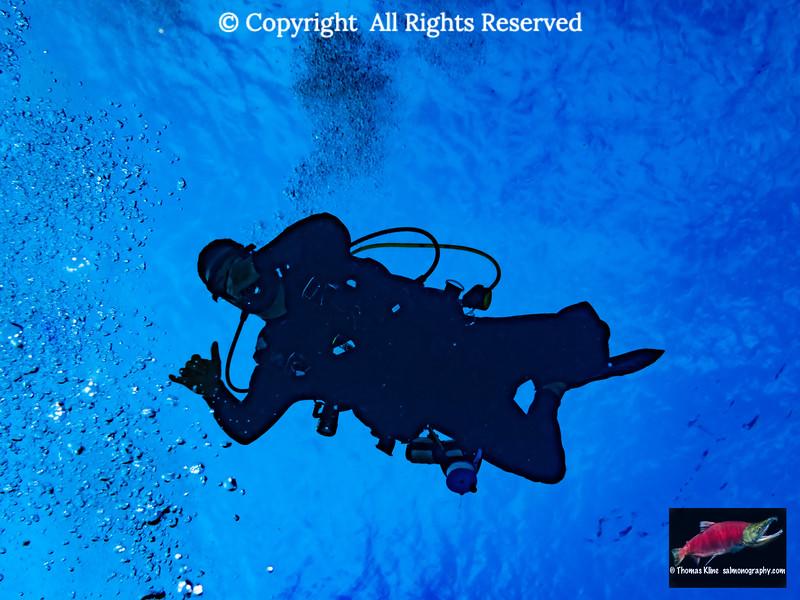 Diver giving shaka sign
