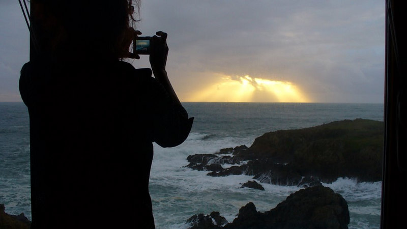 Kandis taking photo of sunset, Sea Ranch CA