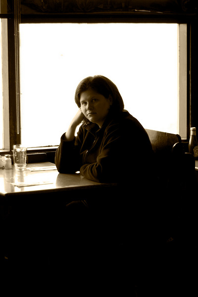 Darcie looking somber at the Athenian Seafood restaraunt