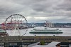 Seattle Great Wheel, 175 ft in diameter. It has 41 eight passenger gondolas and extends out 40 into Elliott Bay beyond the end of its pier. The white and green ship is a ferry to Port Angeles, WA.