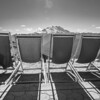 ~~ Watching Mt Rainier ~~<br /> <br /> View of the Mt Rainier from Crystam Mountain Resort overlook. You reach this point via Gondola ride from the resort. The chairs are kept right on the edge for an edge of the seat view.