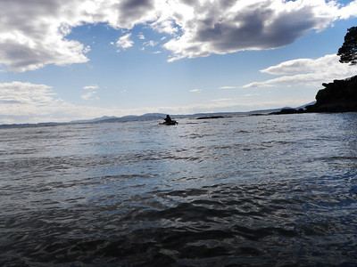 Karen paddles out to sea.