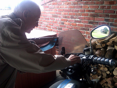 Grandpa fixin' to take Derek's motorcycle for a spin.