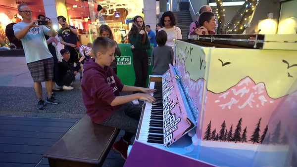 """Kid playing Portugal The Man """"Feel It Still"""" on public piano on Robson St."""