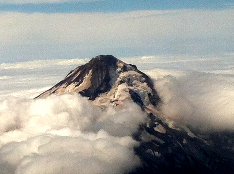 Snapped this pic of Mt Hood with my iPhone as the airliner cruised by it. (Sept, 2013).