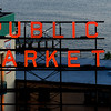 """Public Market"" Sign in Seattle's Pike Place Market - at night.  Elliot Bay is in the background."