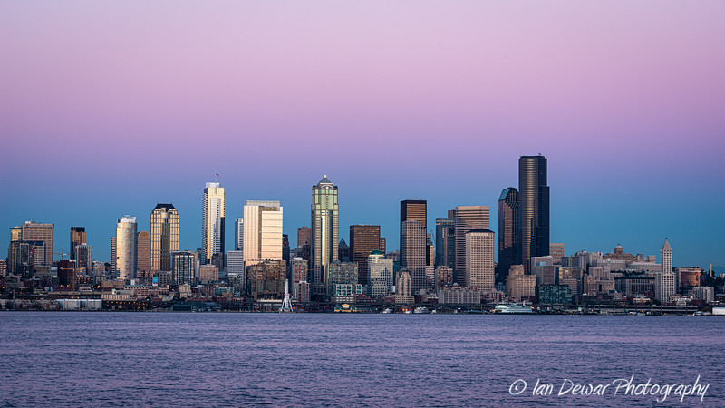 Seattle skyline as the earth's shadow rises behind the city