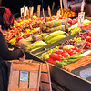 Buying Vegetables - A woman buying fresh produce at the Pike Place Market in Seattle.