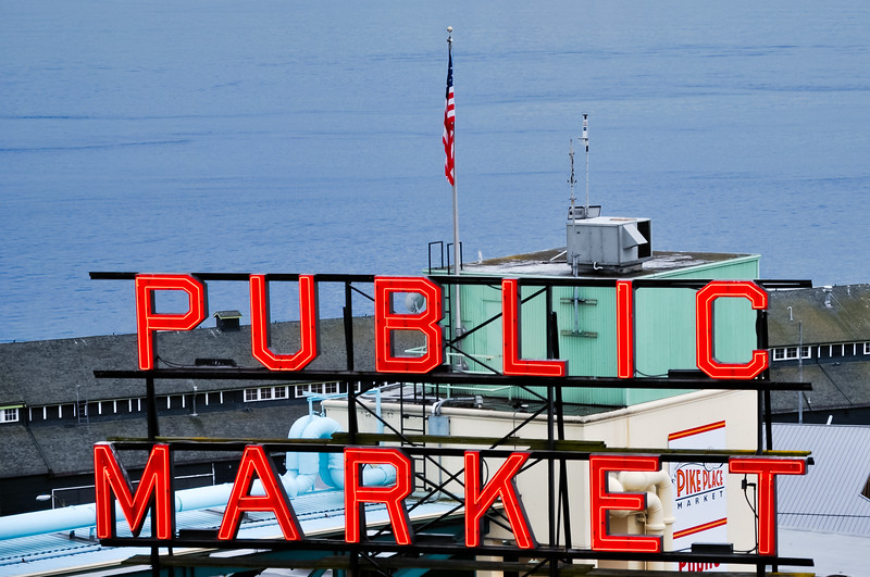 """Public Market"" Sign in Seattle's Pike Place Market - at dusk.  Elliot Bay is in the background."