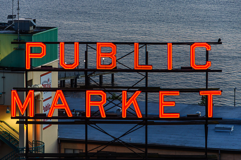 """""""Public Market"""" Sign in Seattle's Pike Place Market - at night.  Elliot Bay is in the background."""