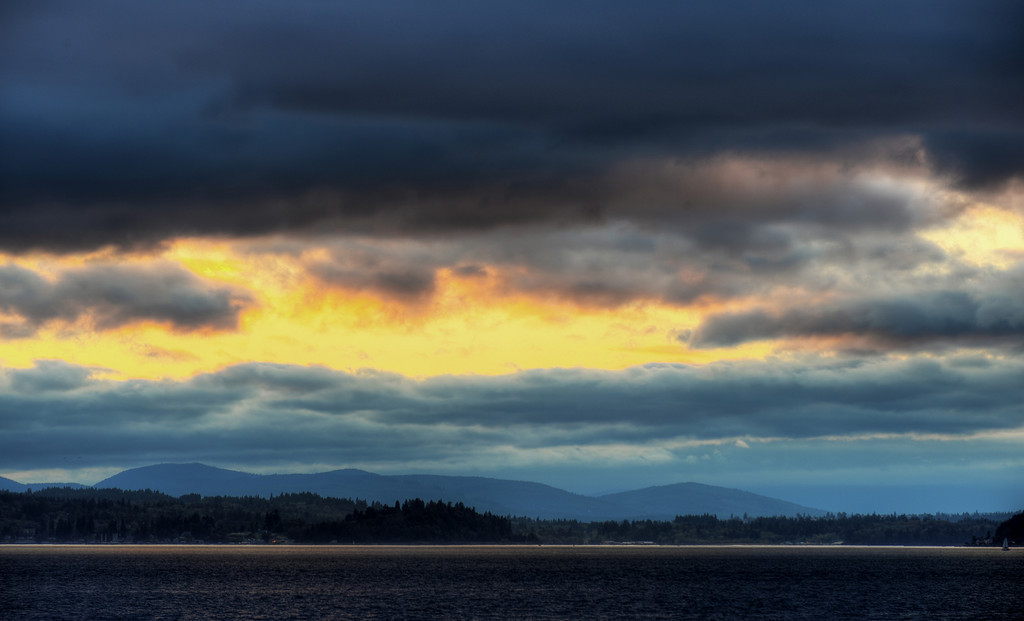 Last sun over Bainbridge Island, via Alki Beach
