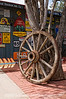 Antique wagon wheel and advertising signs