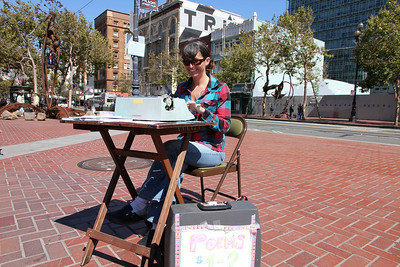 One dollar, three minutes and one poem. I was initially drawn to this anonymous poet by her typewriter, the writing machine of choice during my high school and undergraduate years. It brought back memories. This working poet was remarkably insightful and intuitive - almost clairvoyant. I thought she knew little about me yet hand typed a short poem that was very close to home, too close, it touched me and unsettled me. If I see her again, I will also hire her again.  Photo was taken on Friday, August 26th, 2011 at the United nations plaza, Market Street near 7th Street, San Francisco.