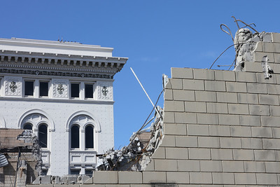A contrast between classic and modern architecture.  The former survives.  In the foreground - United Artists Galaxy Theater, 1285 Sutter Street by Van Ness Avenue.  Closed and in a state of demolition. September 8th, 2011.