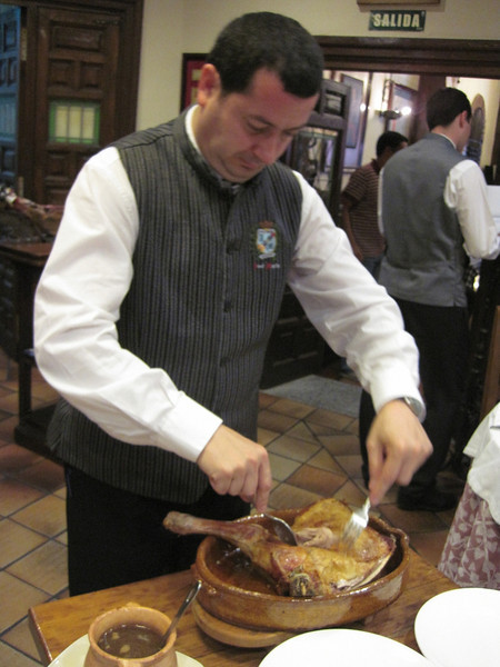 A waiter prepares some meat for serving. Unfortunately, I didn't get a shot of the suckling pig being prepped.